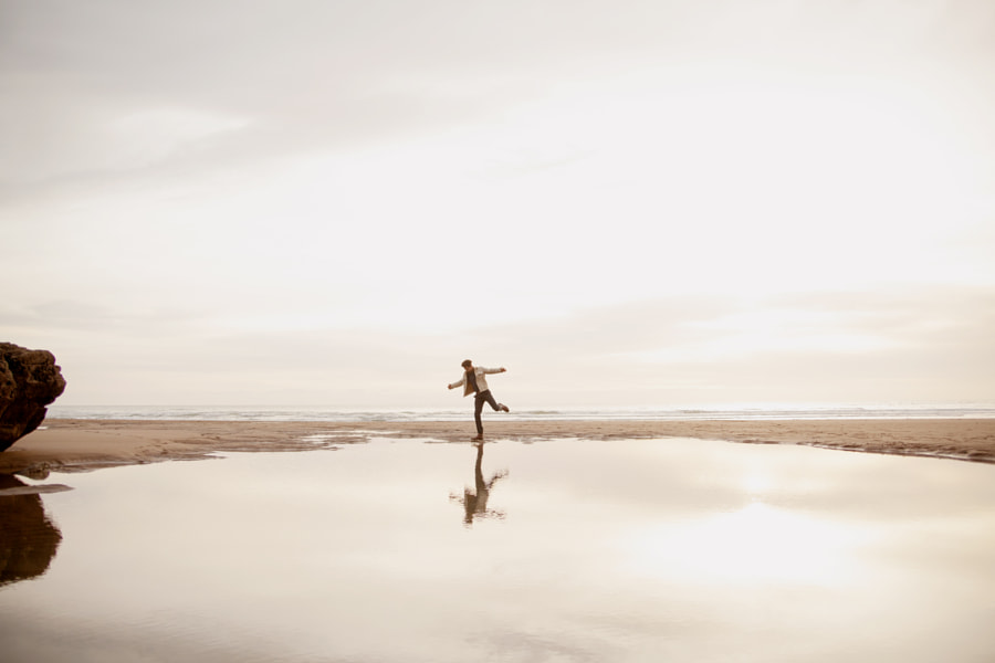 Young biracial dancing and looking at his reflection by Anna Neubauer on 500px.com